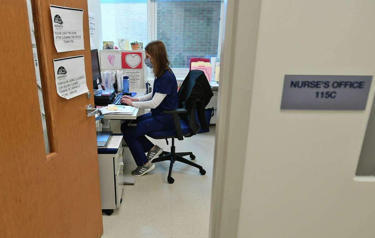 Ponus Ridge Middle School Nurse Jennifer Rolinson Thursday, January 14, 2021, at the school in Norwalk, Conn. School nurses are really doing two jobs now regular school nuersing plus Covid contact tracing and coordination.