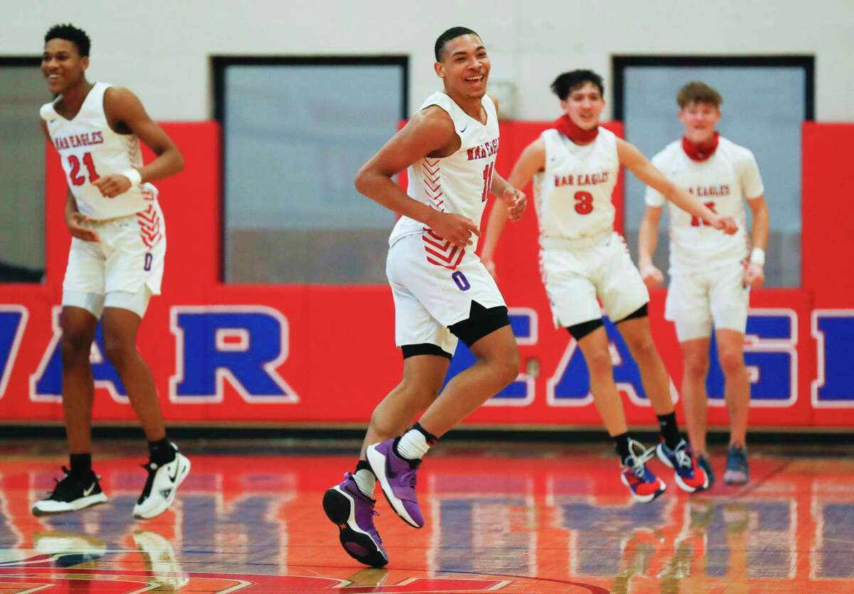 Oak Ridge's Brendon Doucette (11) reacts after a basket by KC Ossai during the fourth quarter of a District 15-6A high school basketball game at Oak Ridge High School, Saturday, Jan. 16, 2021.