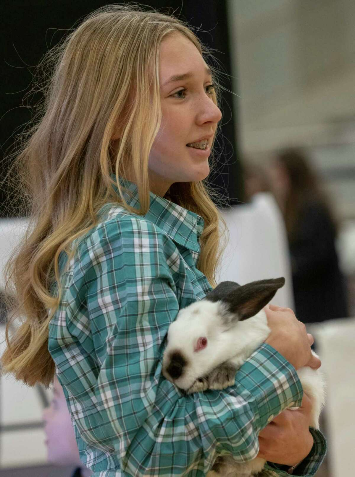 Bailey Morcom shows her Grande Champion rabbit 01/16/2021 during the auction at the 2021 Midland County Livestock Association Show at the Midland County Horseshoe Arena. Tim Fischer/Reporter-Telegram