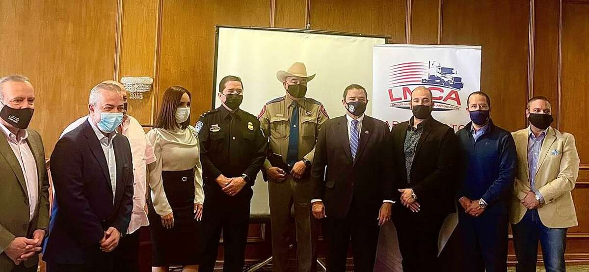Pictured is Rep. Cuellar with CBP Deputy Director Albert Flores, Sergeant Genaro Hinojosa and other State Troopers as well as members of Laredo Motor Carriers Association.