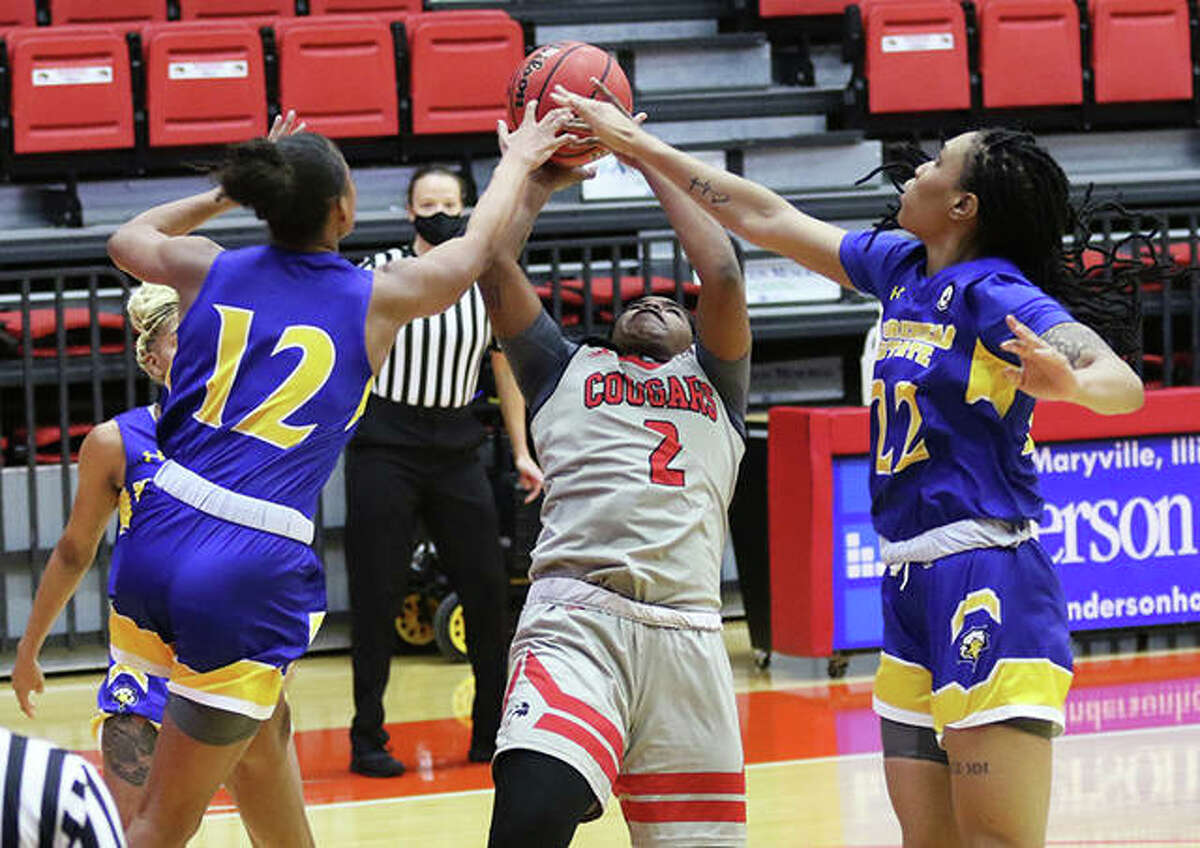 SIUE's Prima Chellis (2) pulls back to get her shot over Morehead State's 6-0 Lauren Carter and 6-2 Gabby Crawford in Saturday's OVC women's basketball game at First Community Arena in Edwardsville