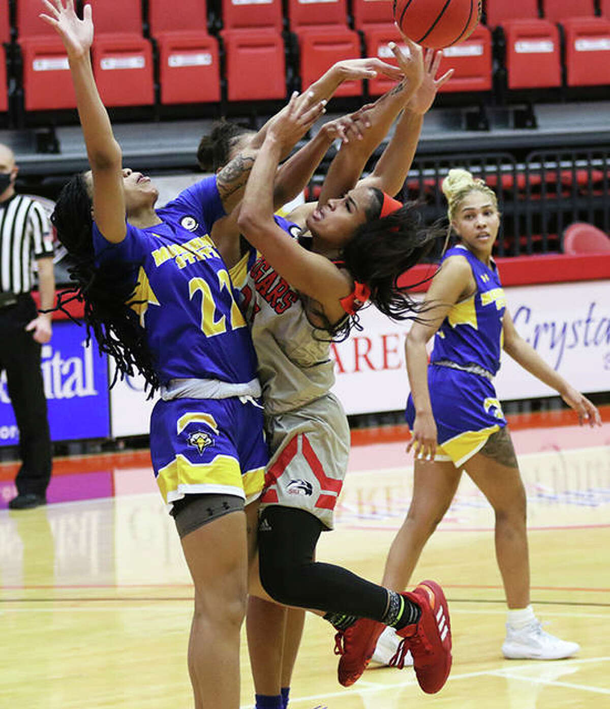 SIUE's Mikala Hall has her shot blocked by Morehead State's Gabby Crawford in the first half at First Community Arena in Edwardsville.