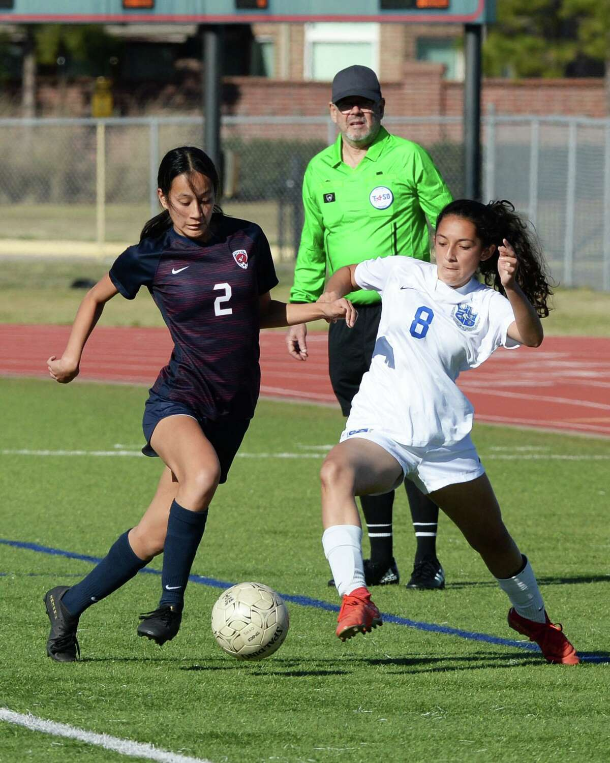 Sydney Nork (2) of Tompkins and Julie Vasquez (8) of Clear Springs compete for a ball during the second half of the girls soccer game in the I-10 Shootout Thursday in Katy.