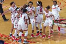 The team comes out to congratulate Sabria Dean (3) on her buzzer-beating basket to end the first half. The Lamar Lady Cardinals downed the Tarleton State TexAnns in their home openier Saturday afternoon at the Montagne Center. Photo made on December 5, 2020. Fran Ruchalski/The Enterprise