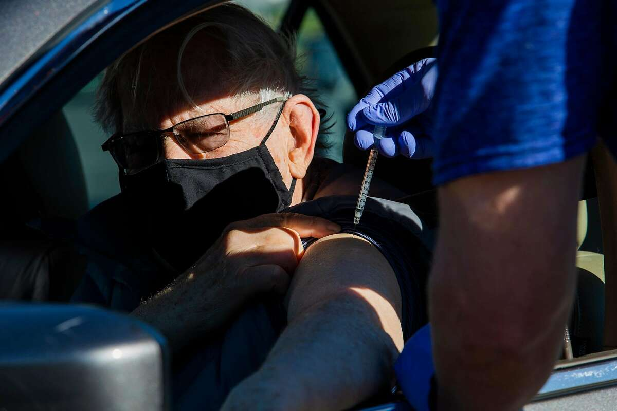 Wayne Hahn, 79, recieves his first Pfizer vaccination for the novel Coronavirus on Janurary 16, 2021 at the Stanley Middle School Parking Lot Drive thru Vaccination center in Lafayette, CA.