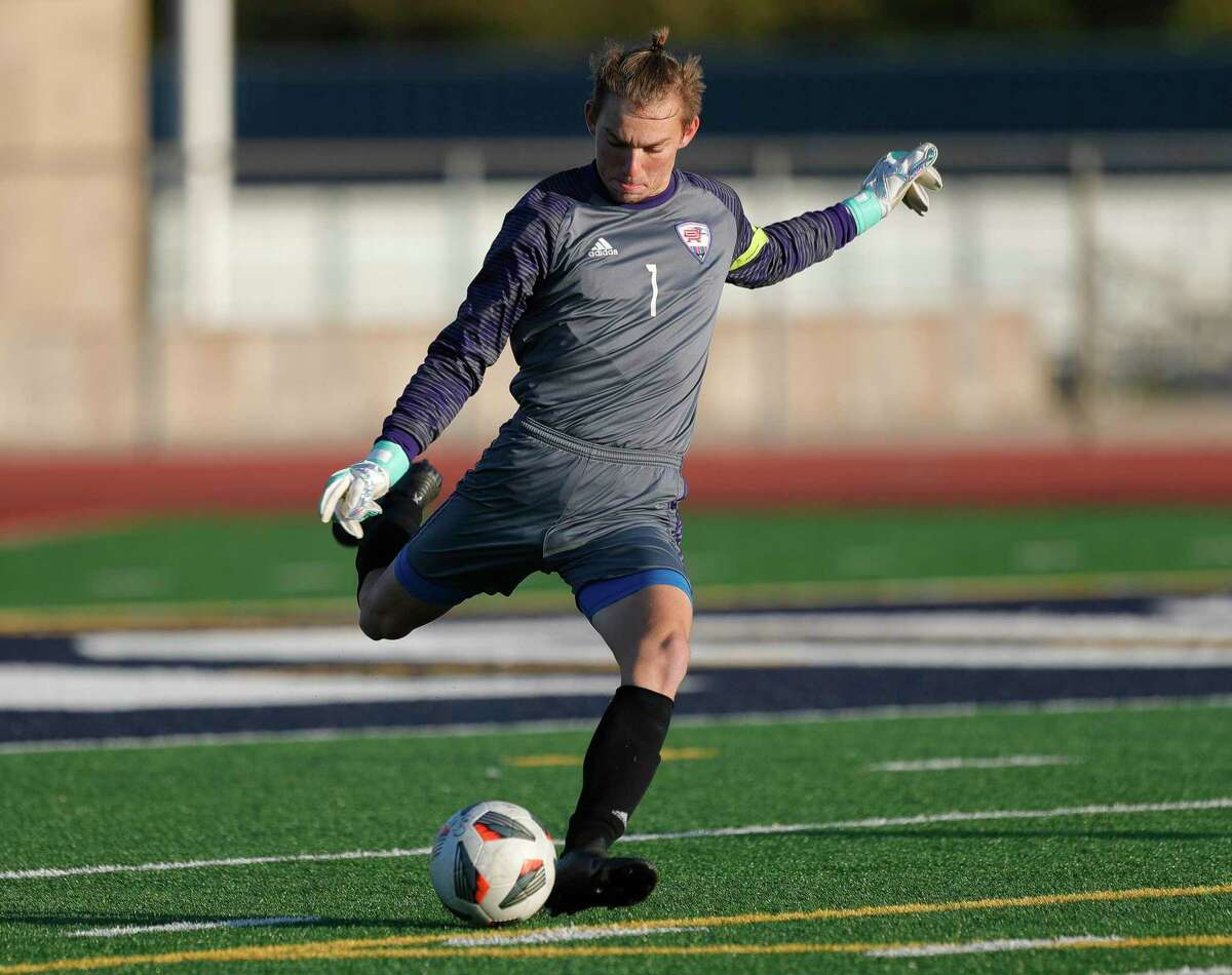 Oak Ridge goalie Lucas Hickey (1) clears the ball in the first period of a soccer match during the Humble ISD Bayou City Classic at Kingwood High School, Friday, Jan. 15, 2021, in Kingwood.
