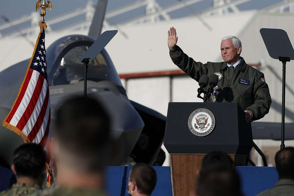 Vice President Mike Pence waves to sailors after speaking at Lemoore Naval Air Station during the Trump White House's last official visit to California.