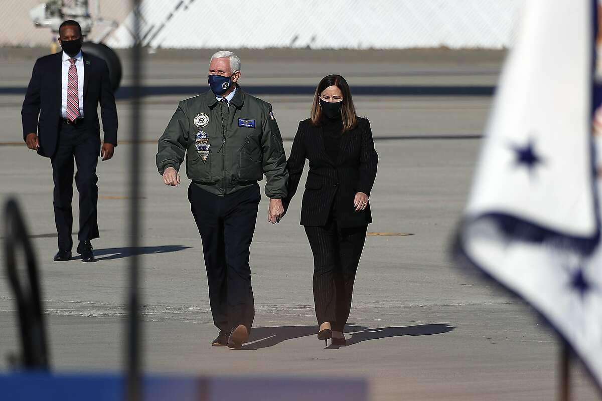 Vice President Mike Pence along with with wife, Karen, arrive to greet a crowd of sailors at Lemoore Naval Air Station on Saturday.