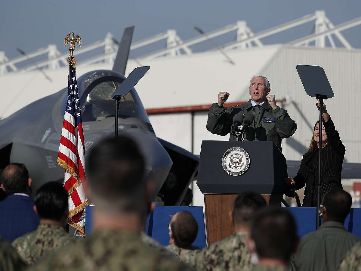 Vice President Mike Pence cheers along with with wife, Karen, as Navy jets fly over before his speech to a crowd of sailors at Lemoore Naval Air Station on Saturday.