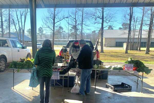Shoppers buying local fresh produce at the Beaumont Farmers' market on Saturday, Jan. 16, 2021 at the Beaumont Athletic Complex in Beaumont, TX. The Enterprise/ Ramos