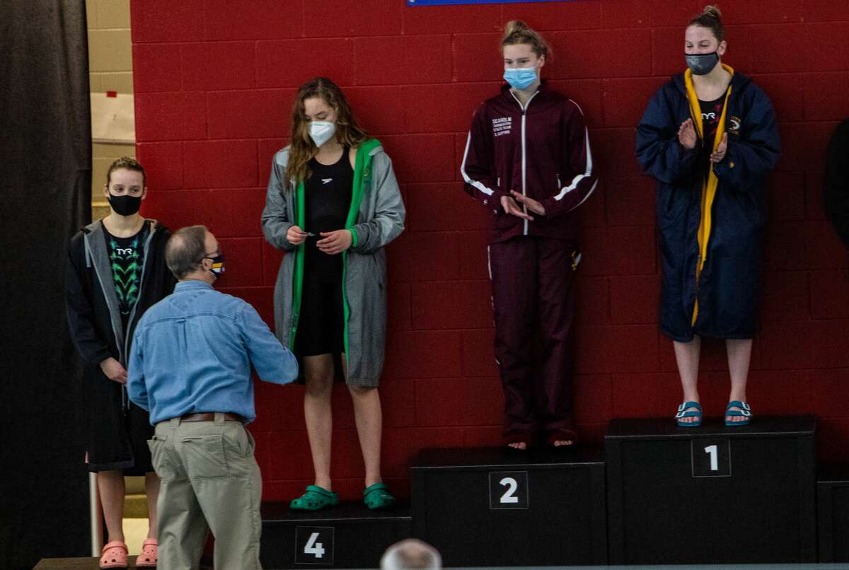 Dow's Ella Roberson, second from left, accepts her 4th place award for the 100 yard freestyle during the MHSAA Girls Division II Swimming and Diving Championships at Northview Aquatic Center Jan. 16, 2021. (Daytona Niles/for the Daily News)