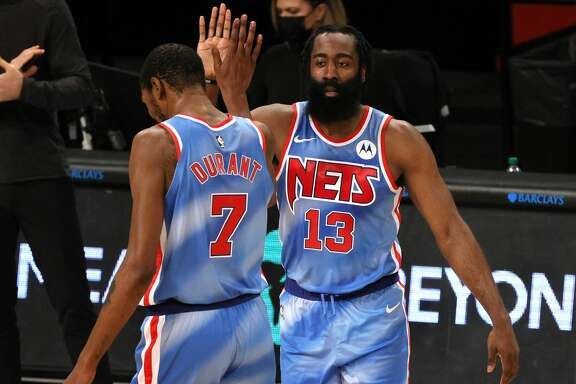 James Harden #13 high-fives Kevin Durant #7 of the Brooklyn Nets during the first half against the Orlando Magic at Barclays Center on January 16, 2021 in the Brooklyn borough of New York City. (Photo by Sarah Stier/Getty Images)