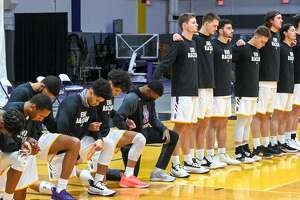 Seven UAlbany basketball players kneeled while others remained standing Saturday night during the national anthem before an America East Conference game against New Jersey Institute of Technology at SEFCU Arena. (Bob Mayberger/UAlbany athletics)