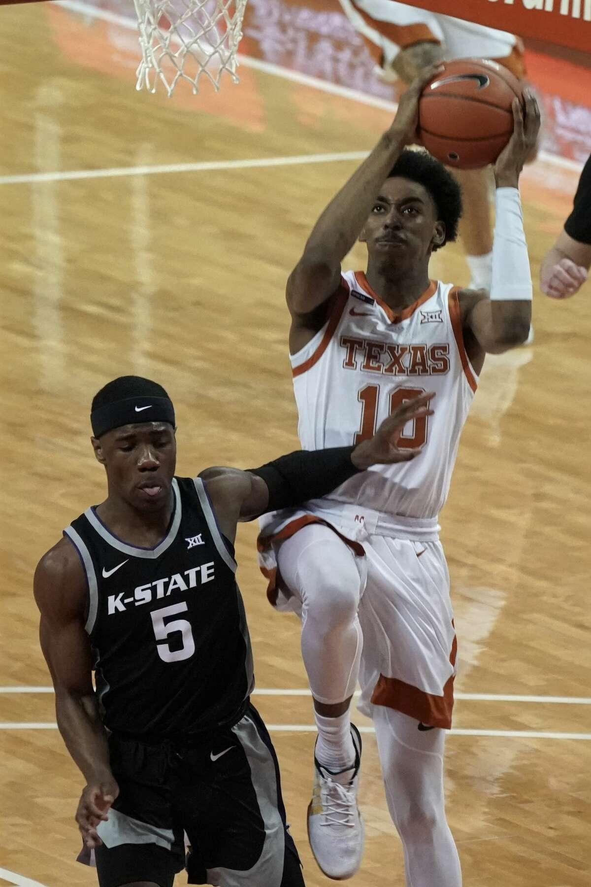 Texas' Donovan Williams (10) drives against Kansas State's Rudi Williams (5) during the first half of an NCAA college basketball game in Austin, Texas, Saturday, Jan. 16, 2021. (AP Photo/Chuck Burton)