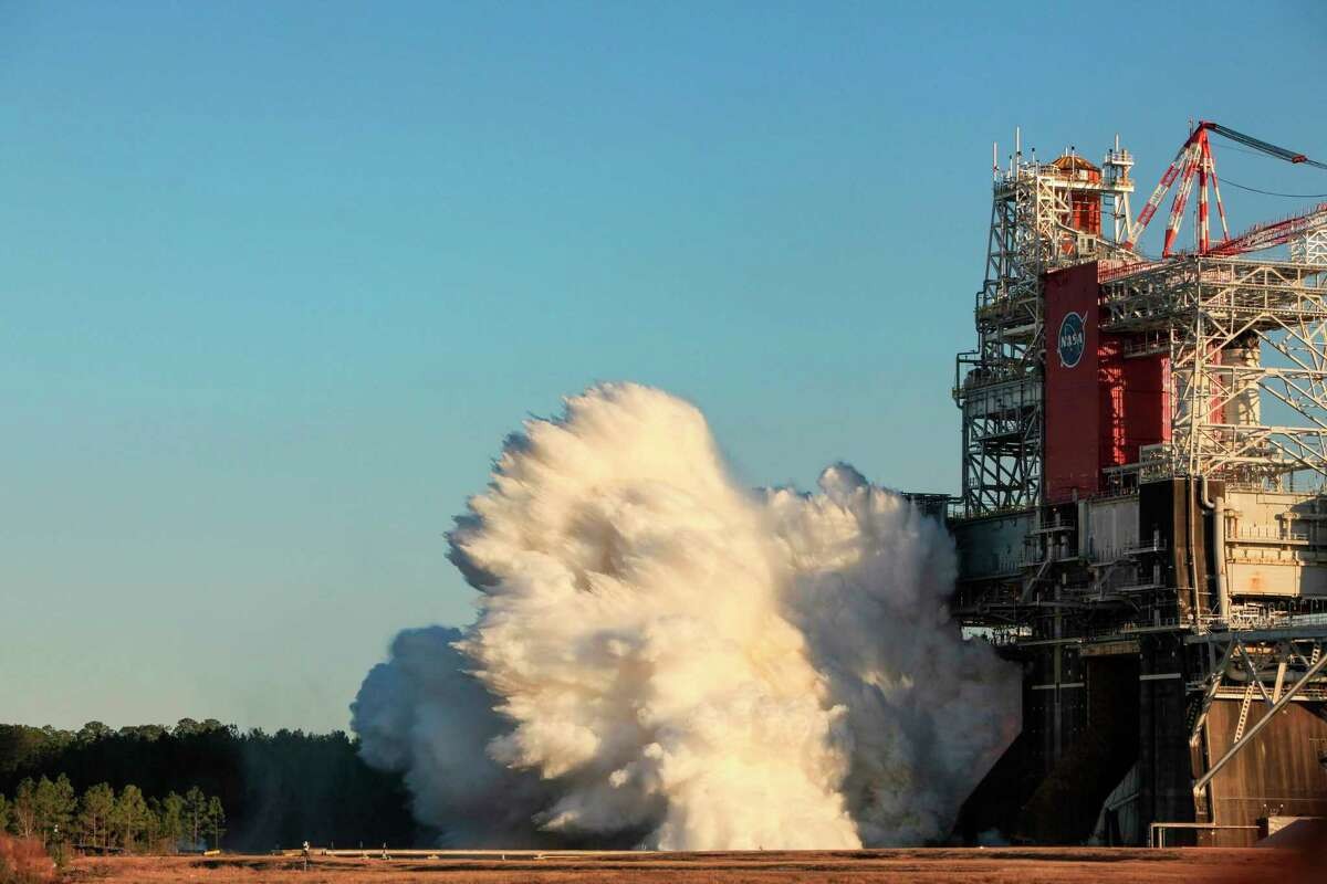This handout photo released courtesy of NASA shows the core stage for the first flight of NASA's Space Launch System rocket in the B-2 Test Stand during a hot fire test, January 16, 2021, at NASA's Stennis Space Center near Bay St. Louis, Mississippi.