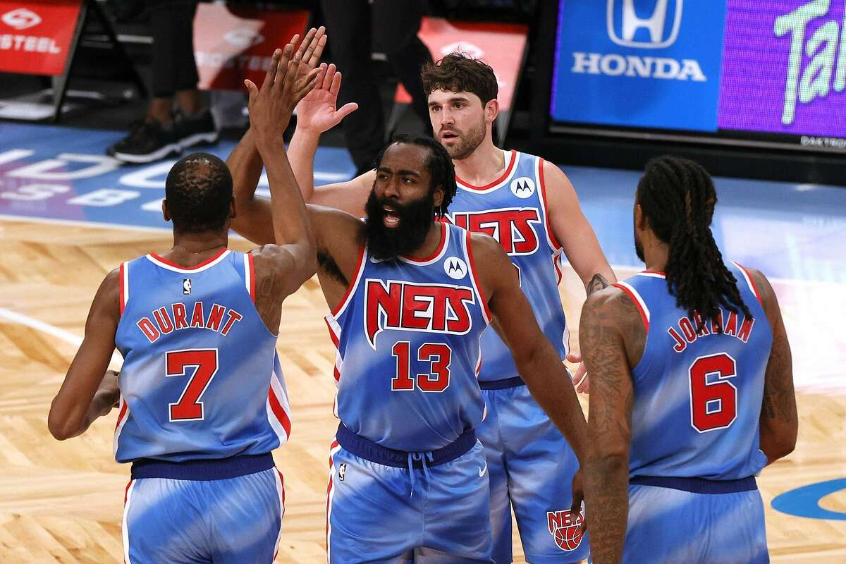 Kevin Durant (left) and new/old teammate James Harden played a lot better than their uniforms looked Saturday.