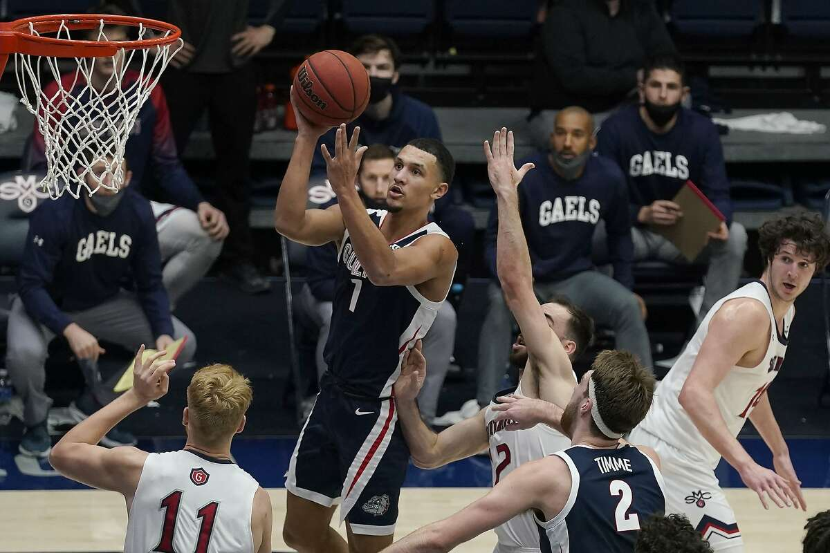 Gonzaga guard Jalen Suggs, middle, shoots against Saint Mary's during the first half of an NCAA college basketball game in Moraga, Calif., Saturday, Jan. 16, 2021. (AP Photo/Jeff Chiu)