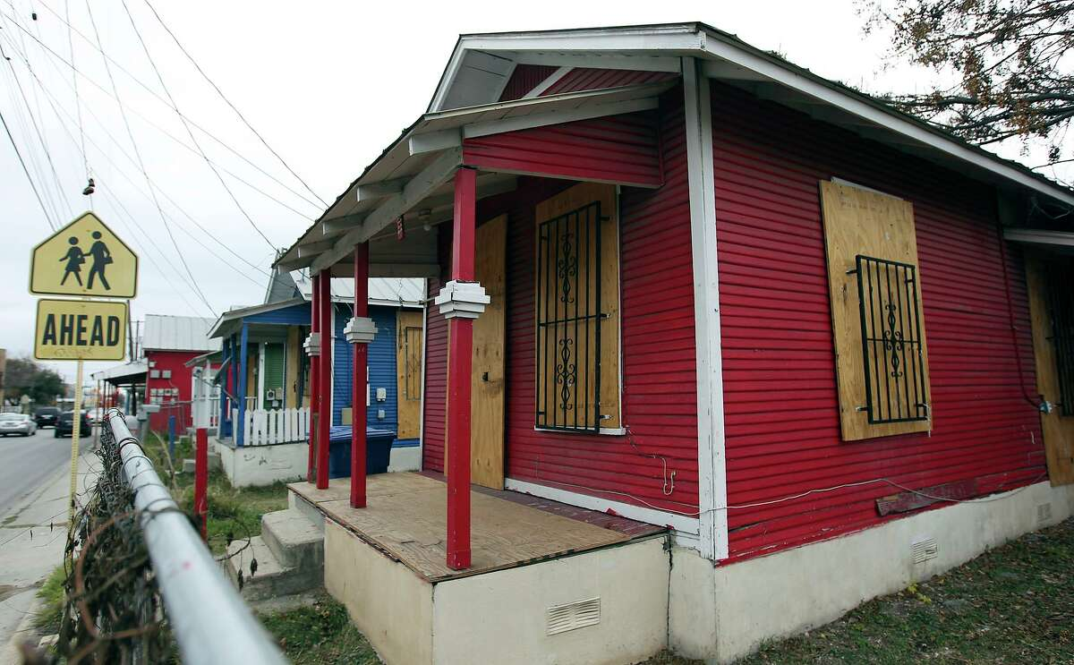 """""""Shotgun"""" houses sit in the 1100 block of Guadalupe in January 2013."""