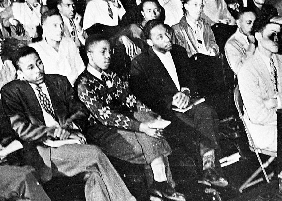 FILE - In this 1948 file photo, Martin Luther King, Jr., third from left, listens to a speaker during an assembly at Morehouse College in Atlanta. As a teenager in 1944, King worked on a tobacco farm in Connecticut. That experience influenced his decision to become a minister. (AP Photo, File)