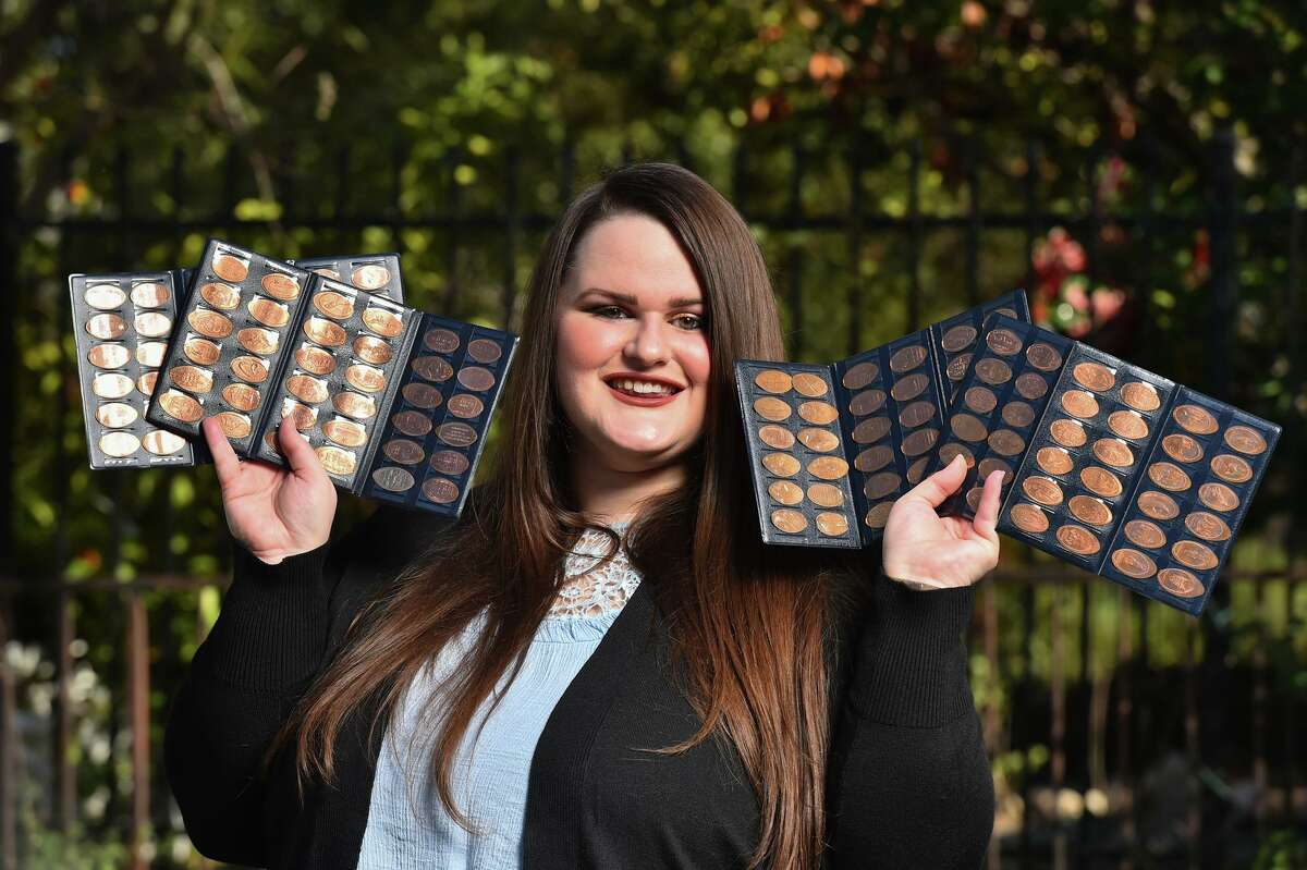 Brandy Gaskins shows off some of her pressed pennies that she's collected from around the world.