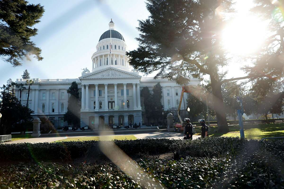 Before possible political protests, California Highway Patrol officers at the state Capitol in Sacramento on Sunday.