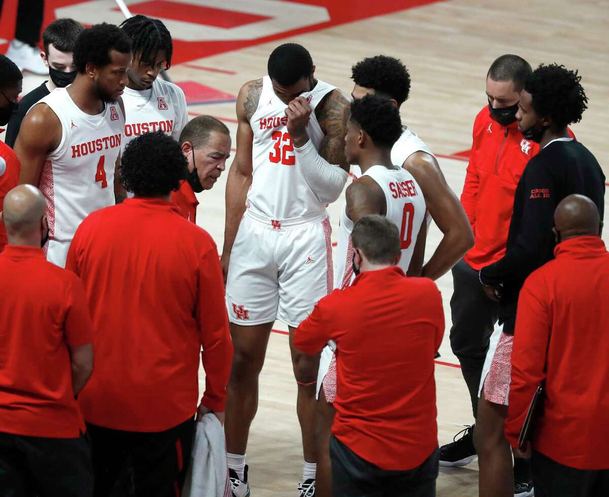 Houston Cougars head coach Kelvin Sampson talks to the team during a time out during the first half of a men's NCAA basketball game at the Fertitta Center, in Houston, Sunday, Jan. 17, 2021.