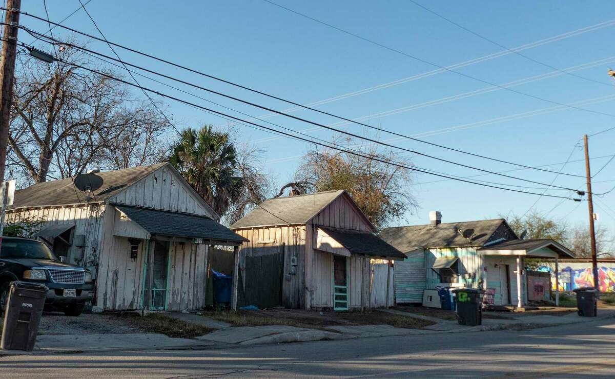 This row of houses on West Ashby includes, at right, at right, a shotgun house thought to have been built in the 1870s. It is one of about 300 spread throughout San Antonio's urban core. They were built from the 1870s to the 1930s for working class families. City officials believe rennovating these old homes may be part of the answer to affordable, energy-efficient housing and job creation.