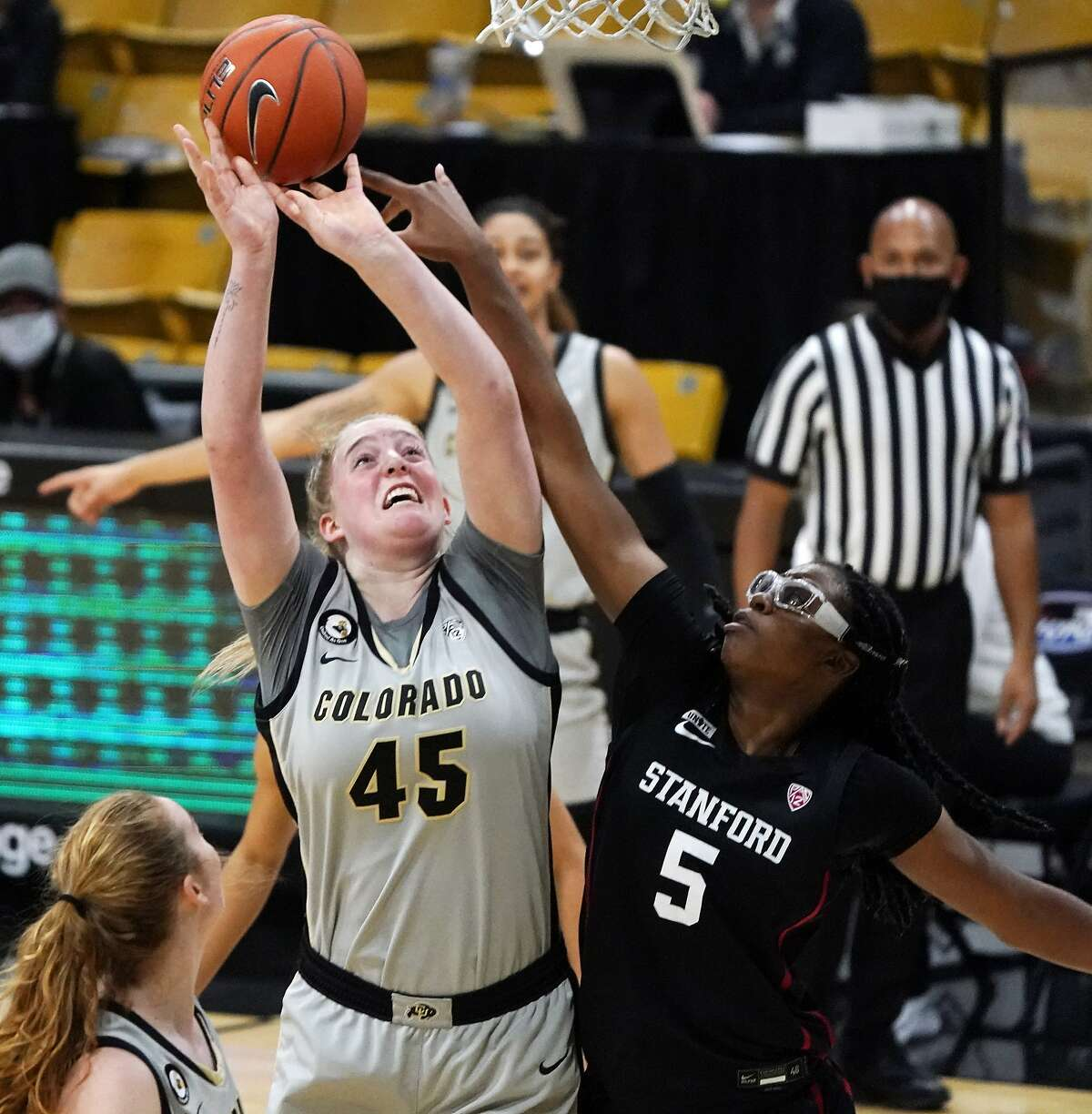 Stanford's Francesca Belibi (5) blocks a shot by Colorado's Charlotte Whittaker in the first half in Boulder, Colo.