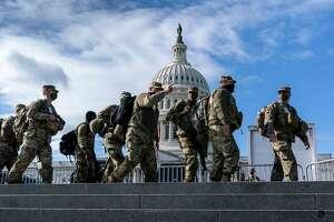 National Guard troops reinforce security around the U.S. Capitol ahead of the inauguration of President-elect Joe Biden and Vice President-elect Kamala Harris, Sunday, Jan. 17, 2021, in Washington. (AP Photo/J. Scott Applewhite)
