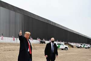 President Donald Trump gives a thumbs up after touring a section of the border wall in Alamo, Texas on Jan. 12, 2021.