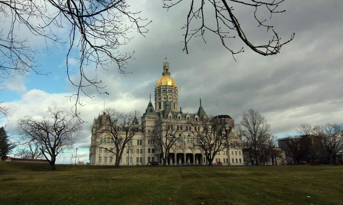 Except for dozens of law enforcement and members of the media present, the State Capitol was a virtual ghost town ahead of planned protests in Hartford, Conn., on Sunday Jan. 17, 2020. Only a handful of protesters eventually came out.