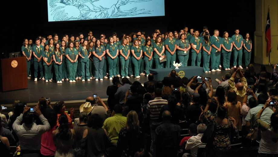 Laredo College Nursing Assistant program and Associate Degree Nursing program students get a standing ovation during their pinning ceremony on May 8, 2018 at the Guadalupe and Lilia Martinez Fine Arts Center. Photo: Danny Zaragoza / Laredo Morning Times / Laredo Morning Times