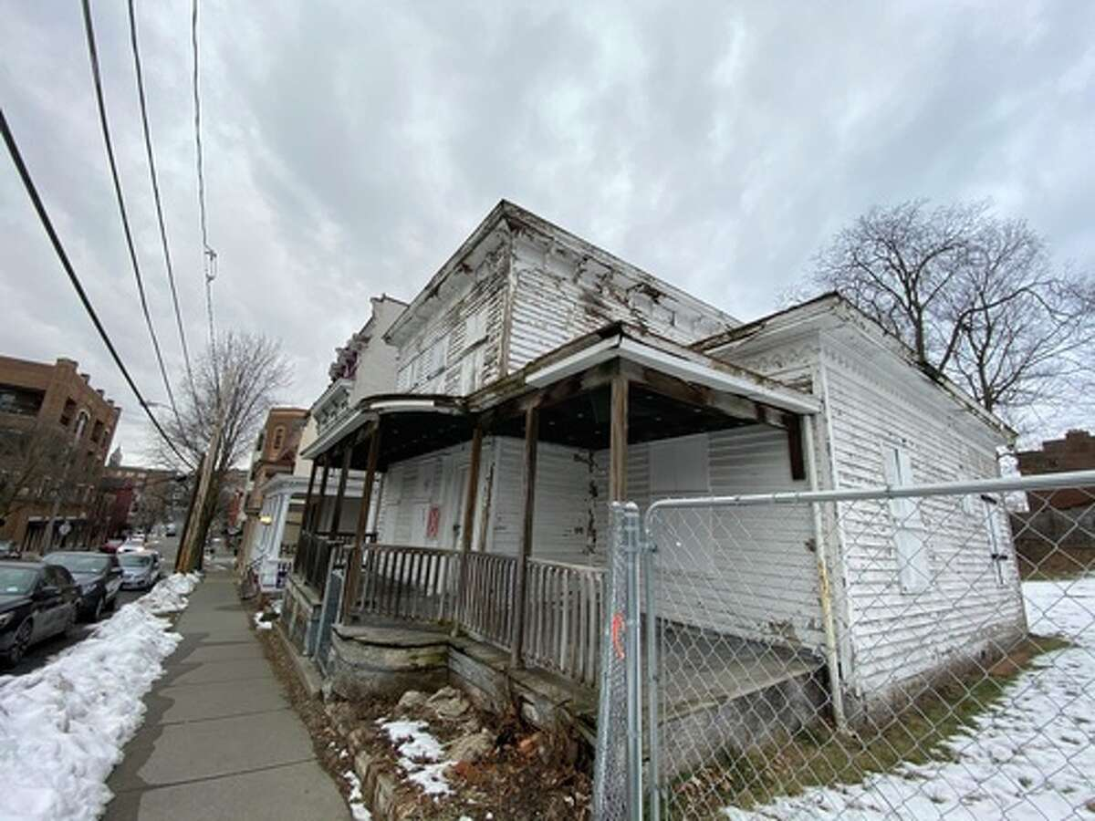 The owners of the houses at 65 (red) and 69 (white) Phila St., Saratoga Springs, requested permission from the city to demolish the structures, which have long been empty and largely unmaintained. Neighbors and the Saratoga Springs Preservation Foundation objected to the request.The houses were built in the 1850s.