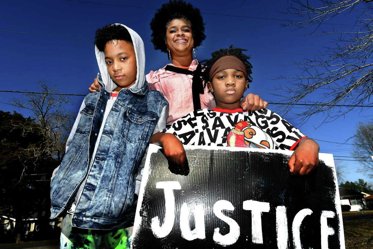 Marinette Landry Parkerson took her sons Damarion Barkin, 11, (left) and Carveal Barkin, 9, to visit the Martin Luther King, Jr., monument in Washington, D.C., for the first time after Christmas.