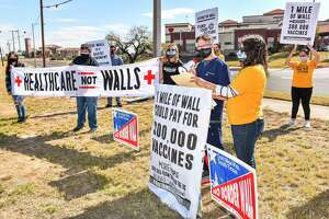 Dr. Carlos Cigarroa and Melissa Cigarroa join the No Border Wall Coalition in its calls for funding healthcare instead of a wall, Sunday, Jan. 17, 2021 across from Laredo Medical Center on Bustamante Street.