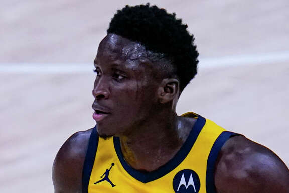 Victor Oladipo plays against the New York Knicks during the first half of an NBA basketball game in Indianapolis, Wednesday, Dec. 23, 2020. (AP Photo/Michael Conroy)