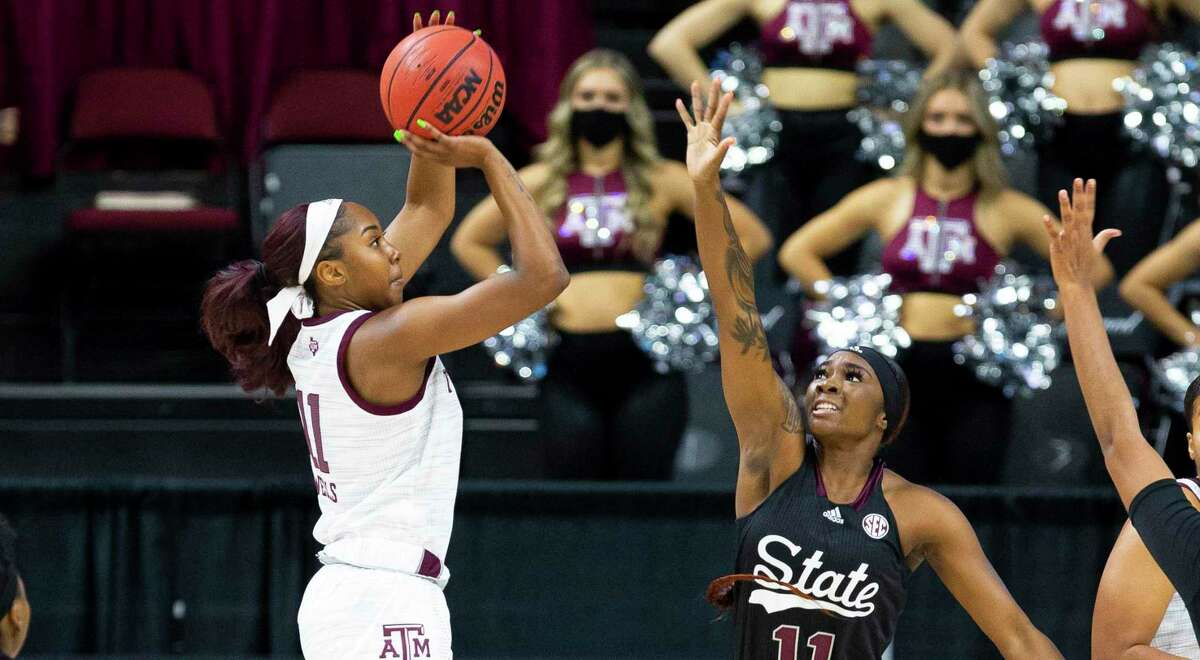 Texas A&M's Kayla Wells, left, led the Aggies with 19 points in Sunday's victory over Mississippi State.