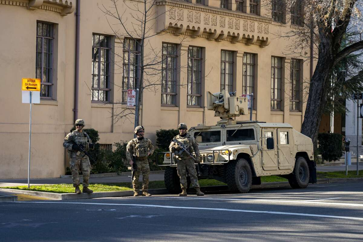 National Guards stand guard securing the California Capitol in Sacramento, Calif. on Sunday, Jan. 17, 2021