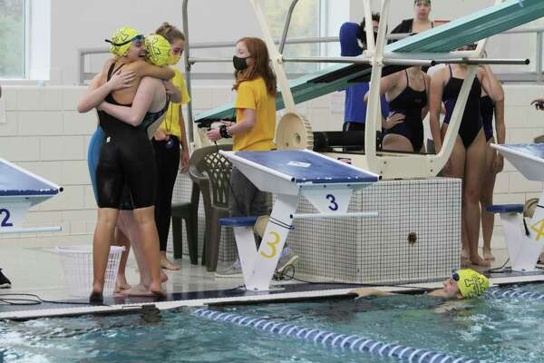 The Manistee Chippewas celebrate hitting a state qualifying time earlier this season. (News Advocate file photo)
