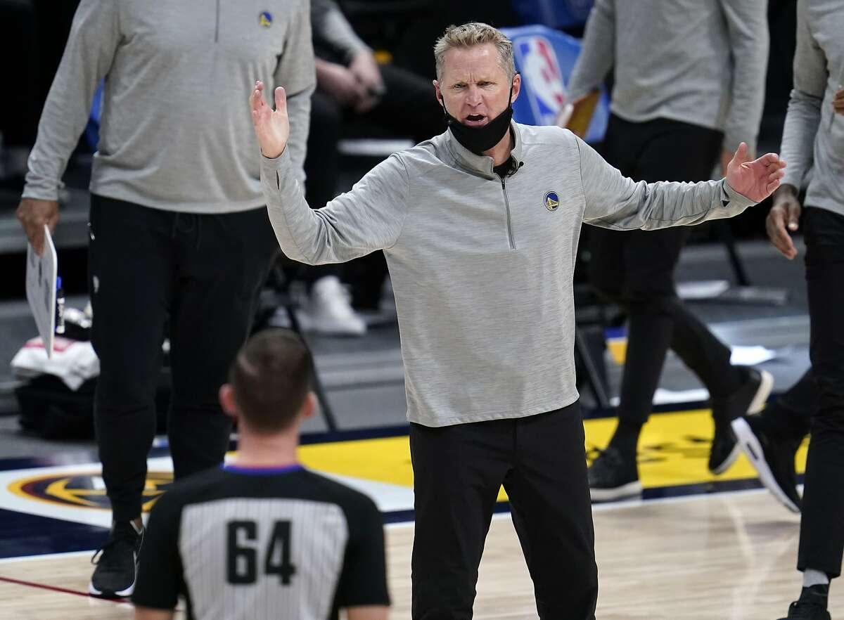 Golden State Warriors coach Steve Kerr argues for a call with referee Justin Van Duyne during the second half of the team's NBA basketball game against the Denver Nuggets on Thursday, Jan. 14, 2021, in Denver. The Nuggets won 114-104. (AP Photo/David Zalubowski)
