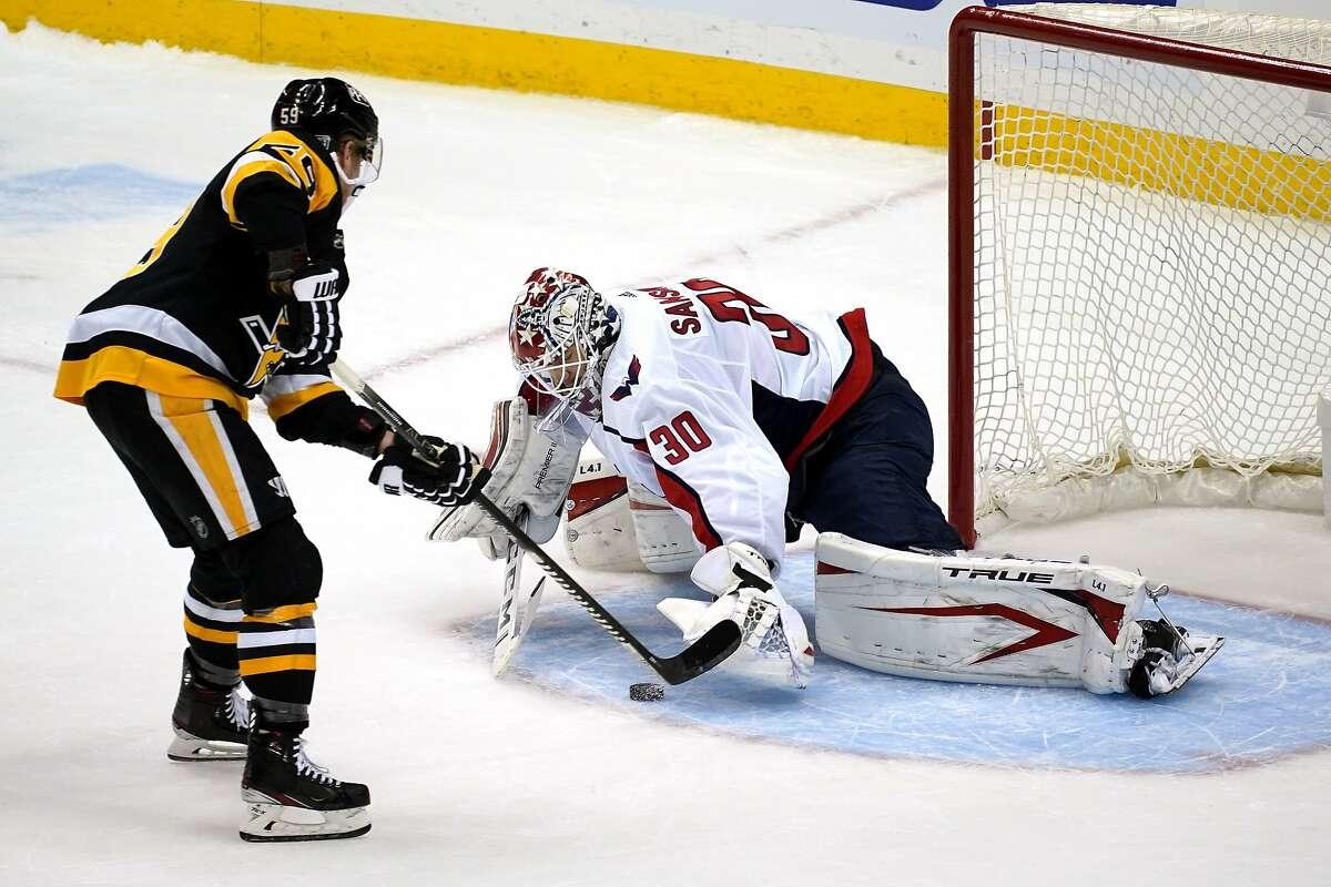 Pittsburgh's Jake Guentzel puts a shot under the glove hand of Washington goalie Ilya Samsonov in the shootout.