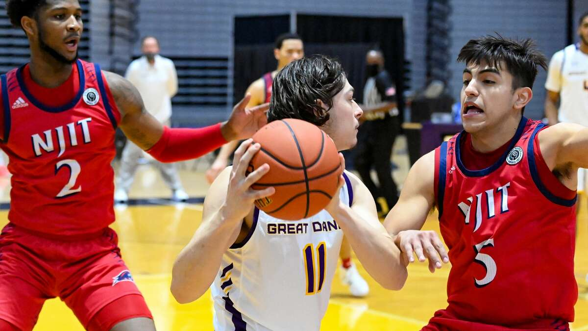 UAlbany guard Cameron Healy (11) is sandwiched by NJIT defenders San Antonio Brinson (2) and Diego Willis in an America East basketball game Saturday, Jan. 16, 2021, at SEFCU Arena. The teams meet Saturday in Hartford, Conn.(Bob Mayberger/UAlbany Athletics)