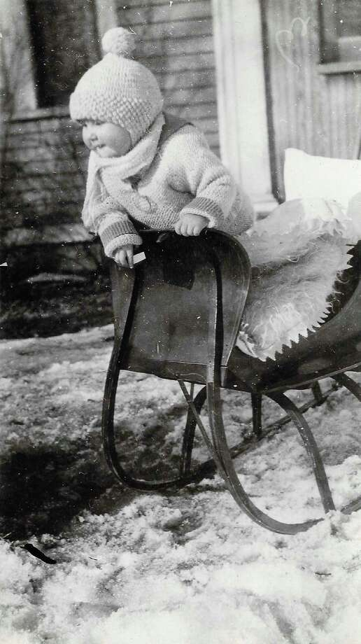 Eleanor Rose of Beulah in a fancy sled stroller. Her father, George Rose, had a store in Beulah. (Courtesy Photo)