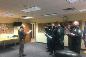 Benzie County Sheriff Kyle Rosa swears in tribal police officers with the Grand Traverse Band of Ottawa and Chippewa Indians to allow them to operate as officers of the law outside of tribal property in Benzie County. (Courtesy Photo)
