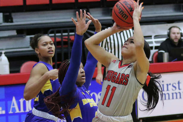 SIUE's Mikia Keith puts up a shot in the lane over a Morehead State defender on Saturday at First Community Arena in Edwardsville. The Cougars play their next five games on the road.