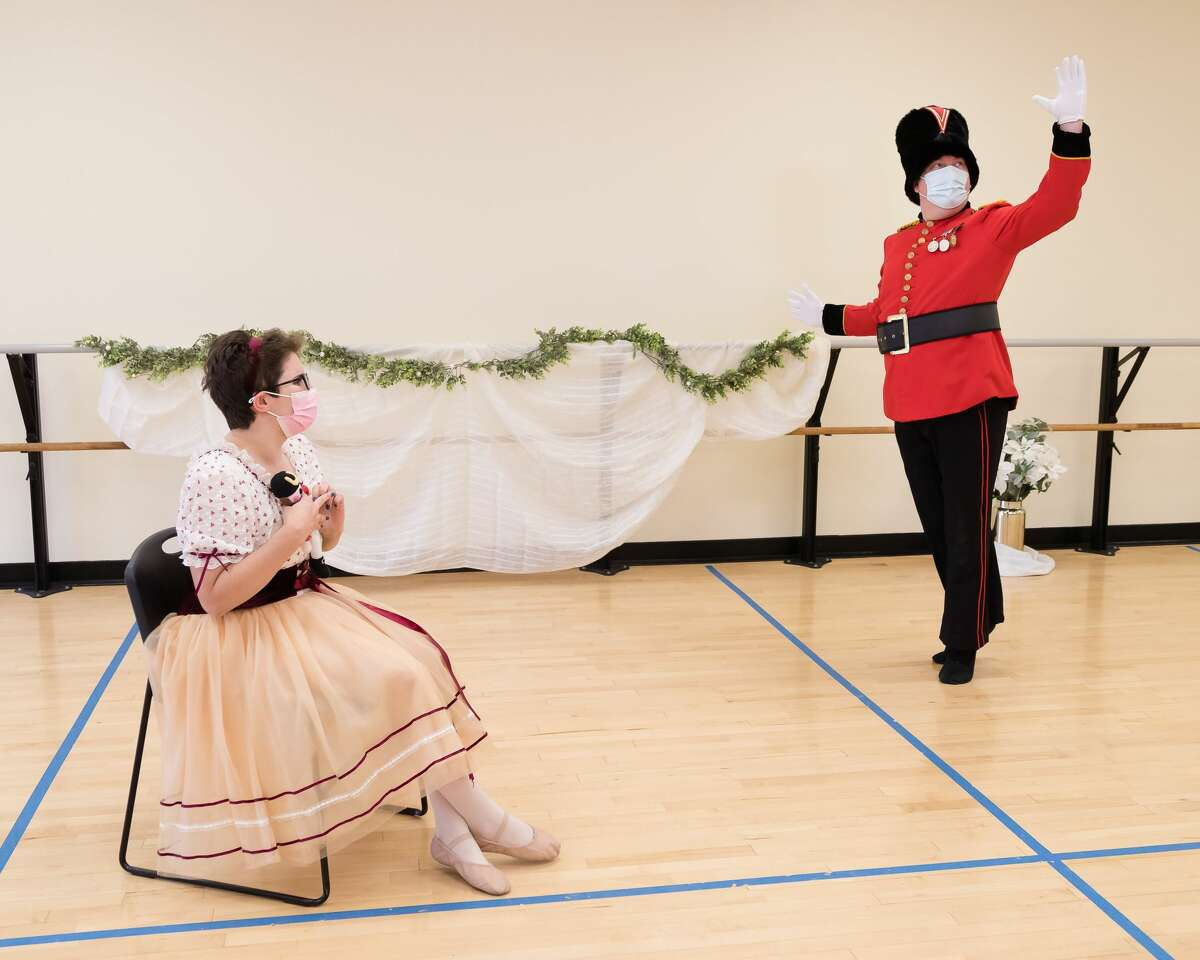 Laura Casellini as Clara, seated, and Eric Meichtry as the Nutcracker (Anthony Tassarotti)