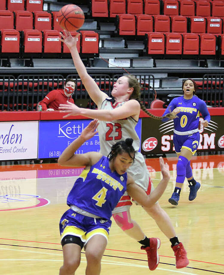 SIUE's Allie Troeckler puts up a shot to beat the buzzer ending the first quarter while Morehead State's Tomiyah Alford (4) ducks past Troeckler and avoids a foul Saturday at First Community Arena in Edwardsville. Photo: Greg Shashack / Hearst Illinois