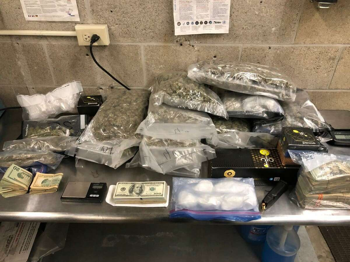 The items seized from a vehicle during a traffic stop and arrest in Meriden, Conn., on Friday, Jan. 15, 2021.