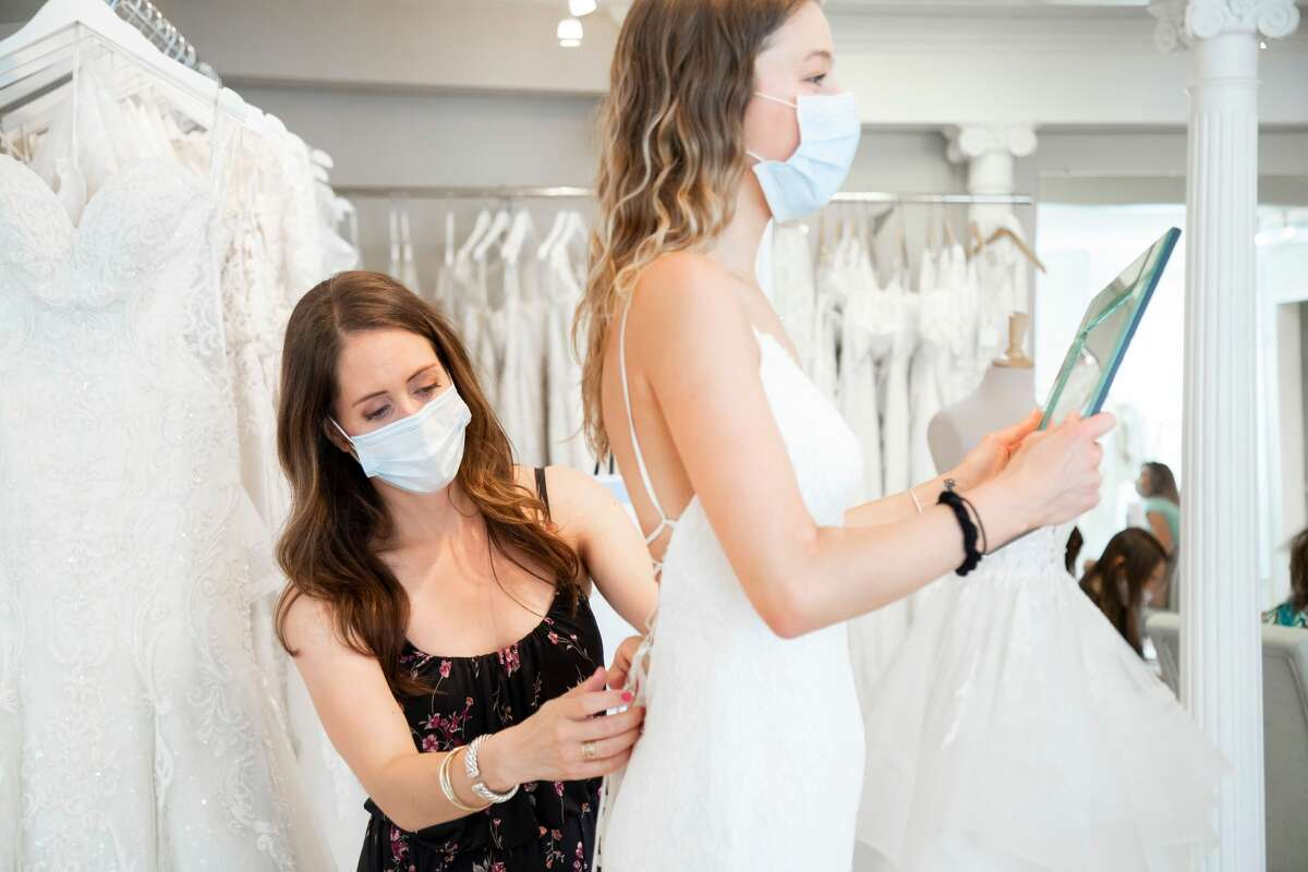 Lauren Mullen, of Lily Saratoga in Saratoga Springs, has seen several changes in wedding dress shopping during COVID.