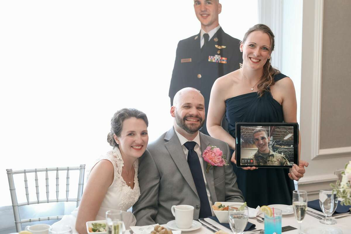 Some couples got creative in remembering people who couldn't be at their wedding ceremonies in 2020, even with cardboard cutouts. Here, Liesl and Stephen Rancour did just that with Stephen's best man.